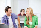 Smiling students looking at each other at school — Stock Photo