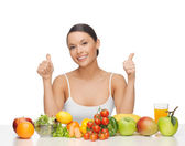 Happy woman with fruits and vegetables — Stock Photo
