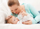 Mother and adorable baby with feeding-bottle — Stock Photo