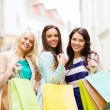 Girls with shopping bags in ctiy — Stock Photo #27829823