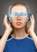Woman in futuristic glasses — Stock Photo