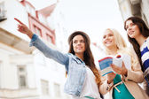 Beautiful girls looking for direction in the city — Stock Photo