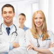 Two young attractive doctors — Stock Photo
