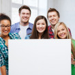 Group of students at school with blank board — Stock Photo