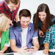 Stock Photo: Students looking into smartphone at school