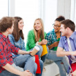 Stock Photo: Students communicating and laughing at school