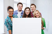 Group of students at school with blank board — Foto Stock