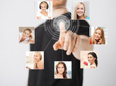Man with virtual screen and contact icons — Stock Photo