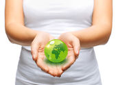 Woman hands holding green sphere globe — Stock Photo