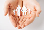 Man with family of paper men — Stock Photo