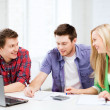 Students chatting in lecture at school — Stock Photo