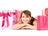 Girl with color gift bags — Stock Photo