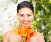 Young woman with bouquet of flowers — Stock Photo