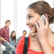 Student girl with cell phone at school — Stock Photo
