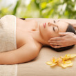 Woman in spa getting facial massage — Stock Photo