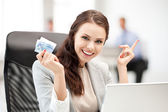 Pensive businesswoman with cash money — Stock Photo