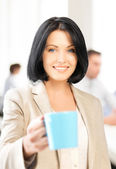 Beautiful businesswoman with cup of coffee — Stock Photo