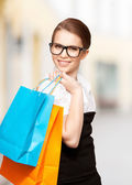Woman with shopping bags in ctiy — Stock Photo