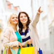 Girls with shopping bags in ctiy — Stock Photo #28640423
