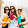 Beautiful girls with bags in the ctiy — Stock Photo #28640461