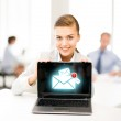 Businesswoman holding laptop with email sign — Stock Photo #28685433
