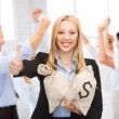 Businesswoman with money bags showing thumbs up — Stock Photo