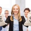 Businesswoman holding money bags with dollars — Stock Photo