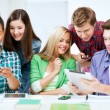 Stock Photo: Students looking at smartphones and tablet pc