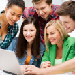 Students looking at tablet pc in lecture at school — Stock Photo #28686197
