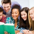 Stock Photo: Students reading book at school