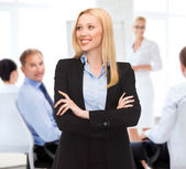 Attractive young businesswoman in office — Stock Photo
