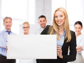 Businesswoman with white blank board — Stock Photo