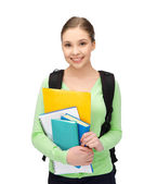 Student with books and schoolbag — Stock Photo