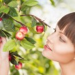 Woman with apple twig — Stock Photo