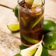 Cocktail with cola ice cubes and lime — Stock Photo