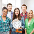 Stock Photo: Group of students at school with clock