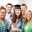 Stock Photo: Girl in graduation cap with certificate