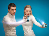 Futuristic man and woman working with gadgets — Photo