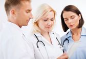 Doctors looking at tablet pc — Stockfoto