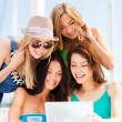 Girls looking at tablet pc in cafe — Stock Photo #28874055