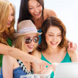 Girls looking at tablet pc in cafe — Stock Photo