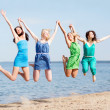 Girls jumping on the beach — Stock Photo #28874257