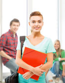 Student girl with folders and school bag — Stock Photo