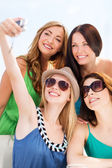 Girls taking photo in cafe on the beach — Stock Photo