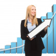 Businesswoman with rising graph and arrow — Stockfoto