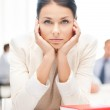 Stressed businesswoman in office — Stock Photo