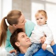 Happy parents playing with adorable baby — Stock Photo #28998053