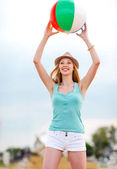 Girl playing ball on the beach — Stock Photo