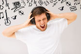 Man with headphones listening loud music — Stock Photo