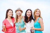 Girls with drinks on the beach — Stock Photo